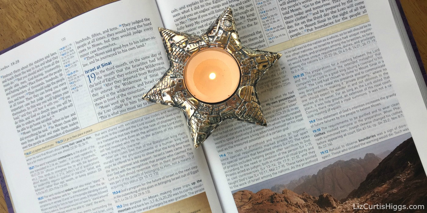 Jerusalem Candle on a Bible Open to Exodus